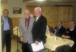 Service award to Don Rattle for 20 years of service (with lion Ken Drynan)
